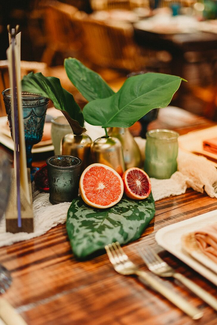 Modern Centerpieces with Tropical Fruit and Leaves