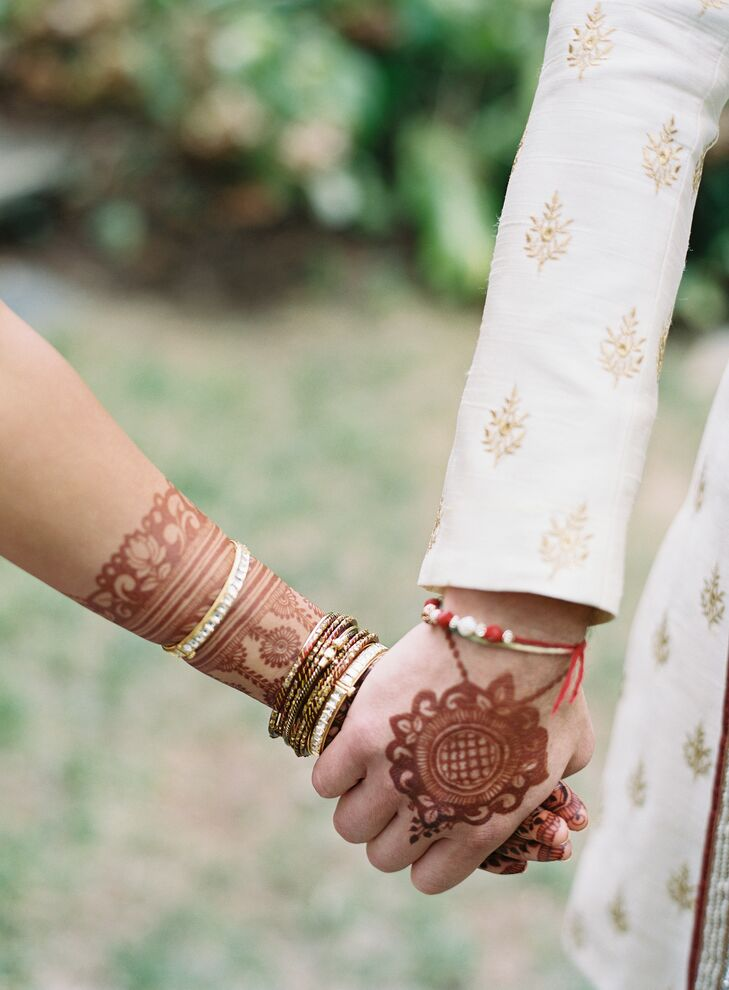 Couple with Henna Holding Hands During Wedding
