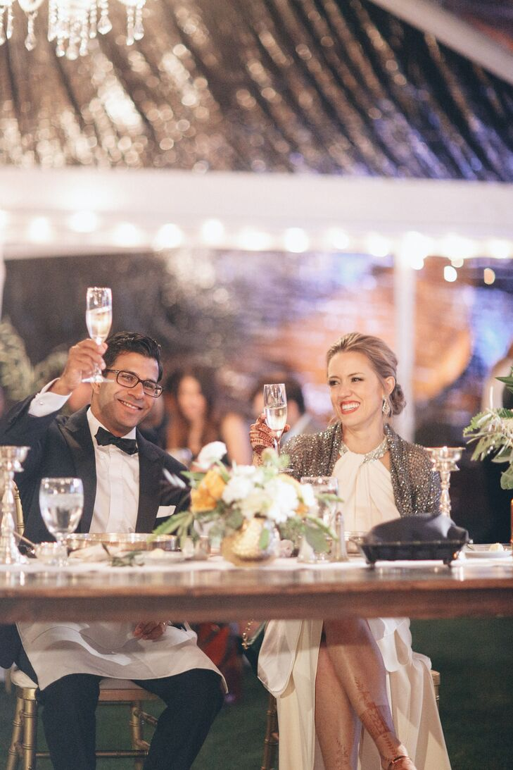 """At the dance, the couple had shawls and flip-flops available for cold shoulders and tired feet. """"The little details helped make our family and friends comfortable, and let them know how glad we were to have them with us on our big day."""""""