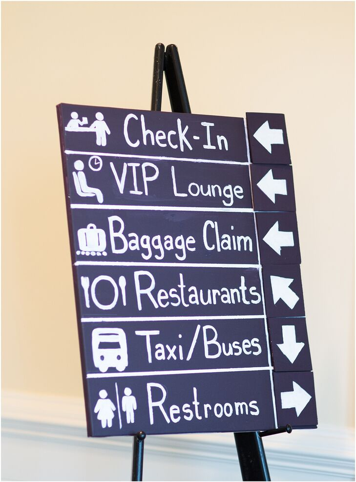 As a nod to Josh's work as a commercial airline pilot, the couple incorporated a travel theme into the day, including airport-inspired signs, luggage tags and tables named after major airlines.
