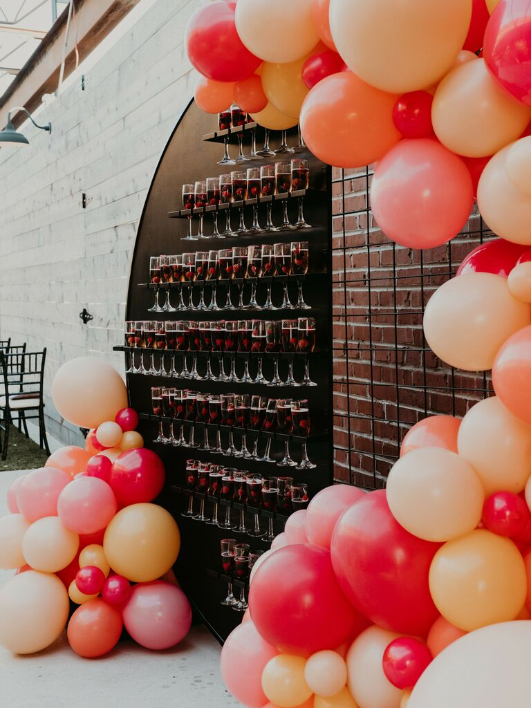 wedding vendor confessions champagne welcome wall with balloons