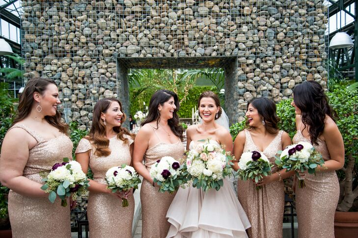 "Planterra provided the floral arrangements. ""I wanted soft and deep colors to match my dress and contrast with all the greenery,"" Katina says. The bridesmaids wore sparkling Sorella Vita gowns in blush gold."