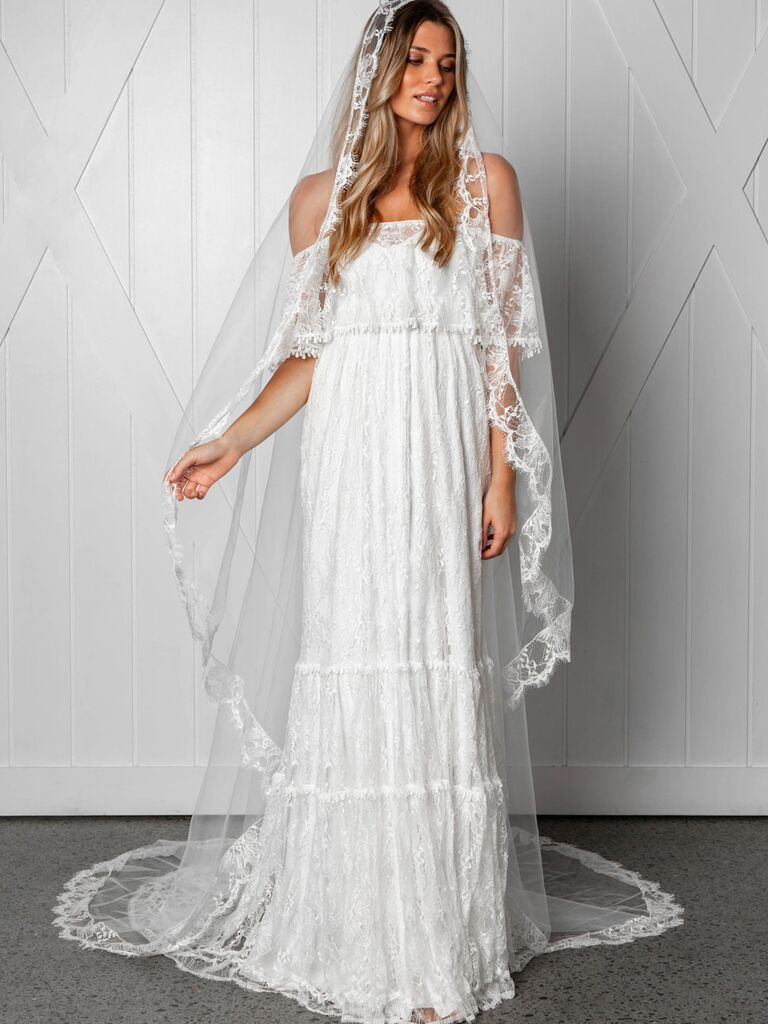 Grace Loves Lace Fall 2019 Bridal Collection off the shoulder bohemian sheath dress with tiered embroidery