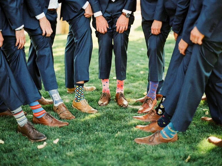 Groomsmen showing off printed socks