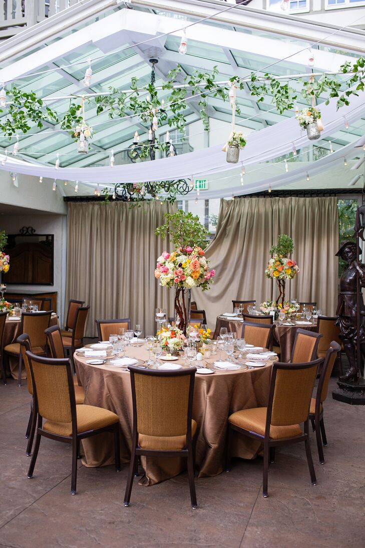 The reception was decorated with draping ivy, hanging mercury glass floral arrangements and string lights for an ethereal garden feel.