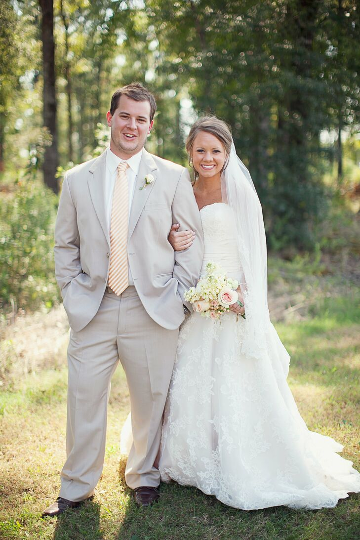 Laura and Andrew's outdoor wedding was held at Tri Oaks Farm in Monroe, LA. Lavish floral arrangements with unique details like featherlike plants and