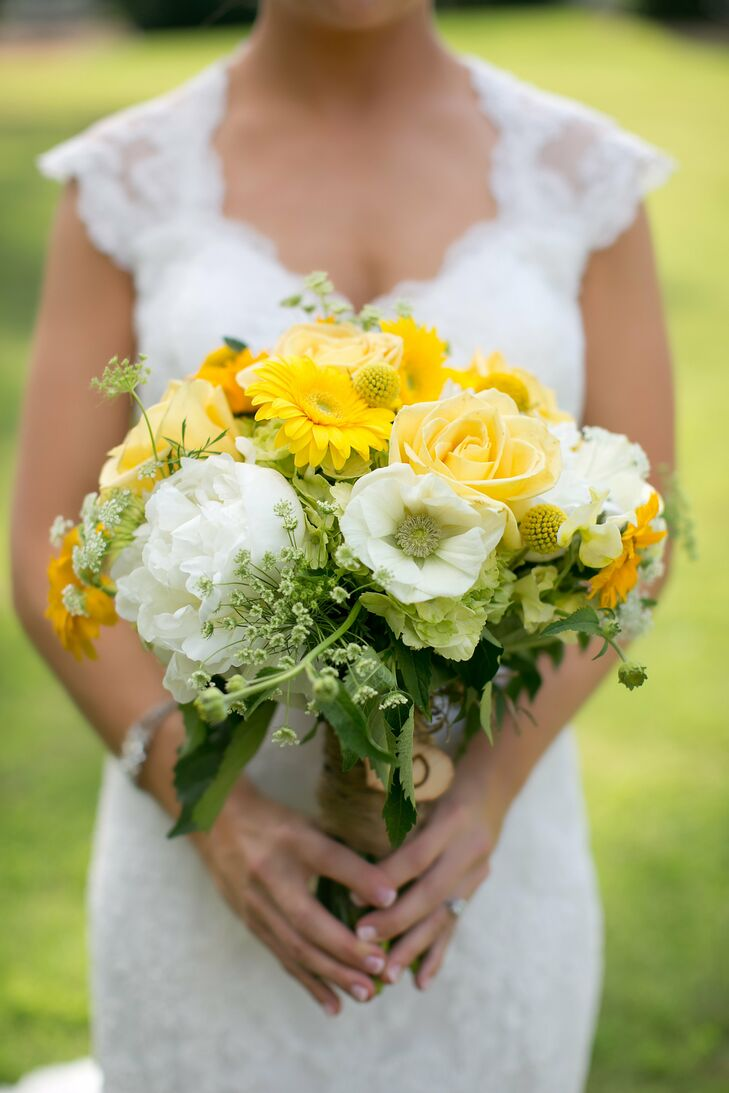 Lindsay loved the effortless look of her twine-wrapped bouquet of yellow roses, baby's breath, craspedia, peonies and gerbera daisies.
