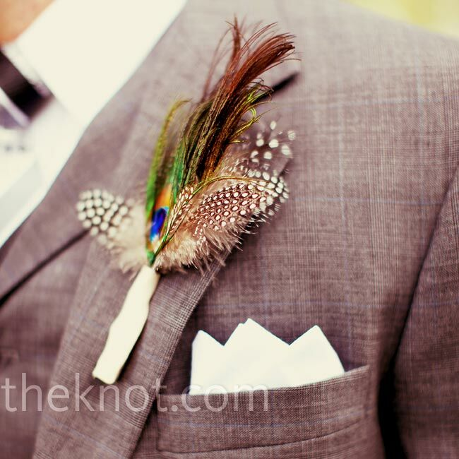 The light gray jackets the groom and his attendants wore were decorated with a bout of brightly colored feathers with a vintage vibe.