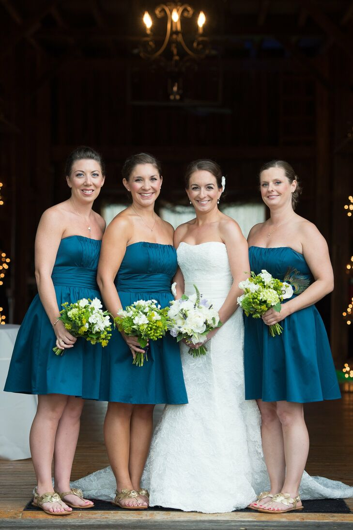 Kathryn had two bridesmaids and a maid of honor. All of the girls wore peacock-blue dresses and gold sandals. As a thank you gift for each girl Kathryn gave them all a necklace make with their birthstone and initial, which they wore during the wedding.  To add some interest to the dresses they each wore a silk flower pin that was adorned with peacock feathers.  These pins matched Kathryn's peacock hair piece.