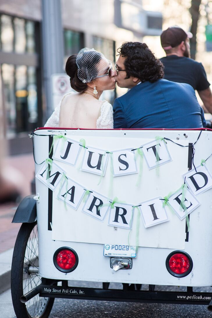 After the courthouse ceremony, a pedicab took the couple on a private tour of Portland, Oregon, stopping for photos at favorite sites.
