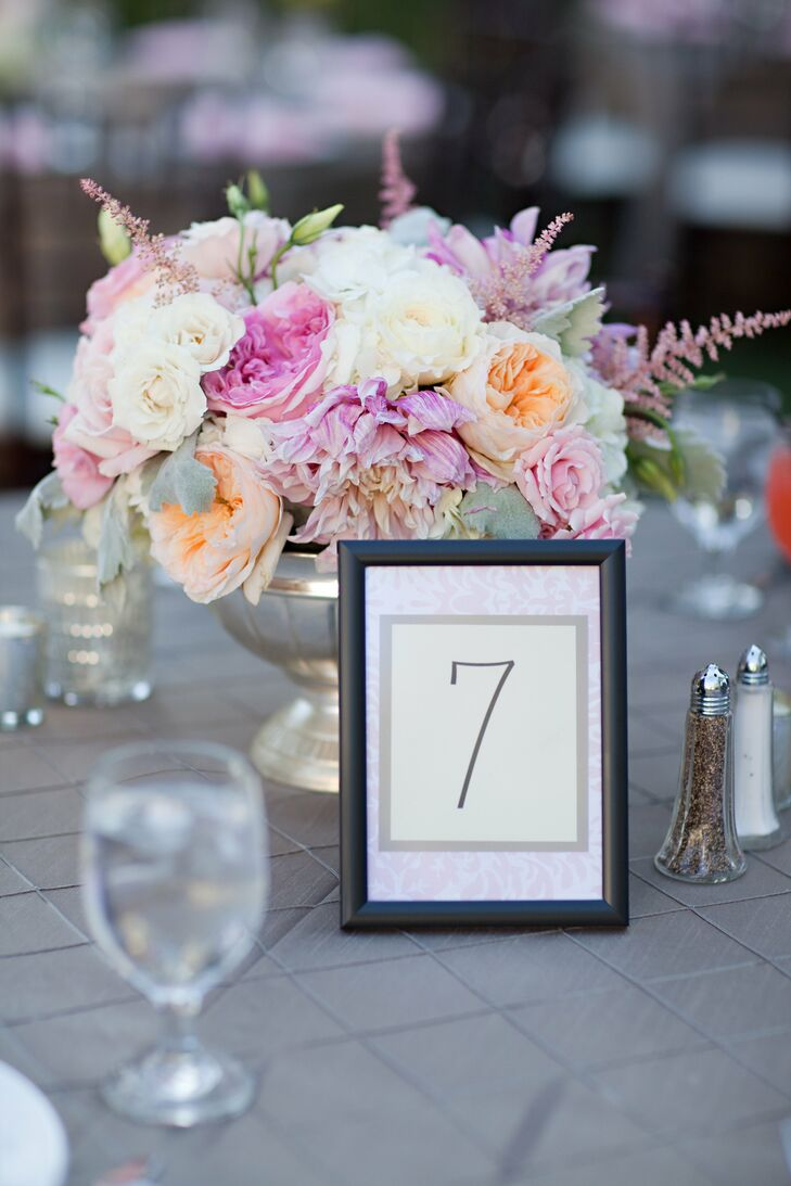 A lovely arrangement of pastel garden roses added a romantic touch to the table decor.