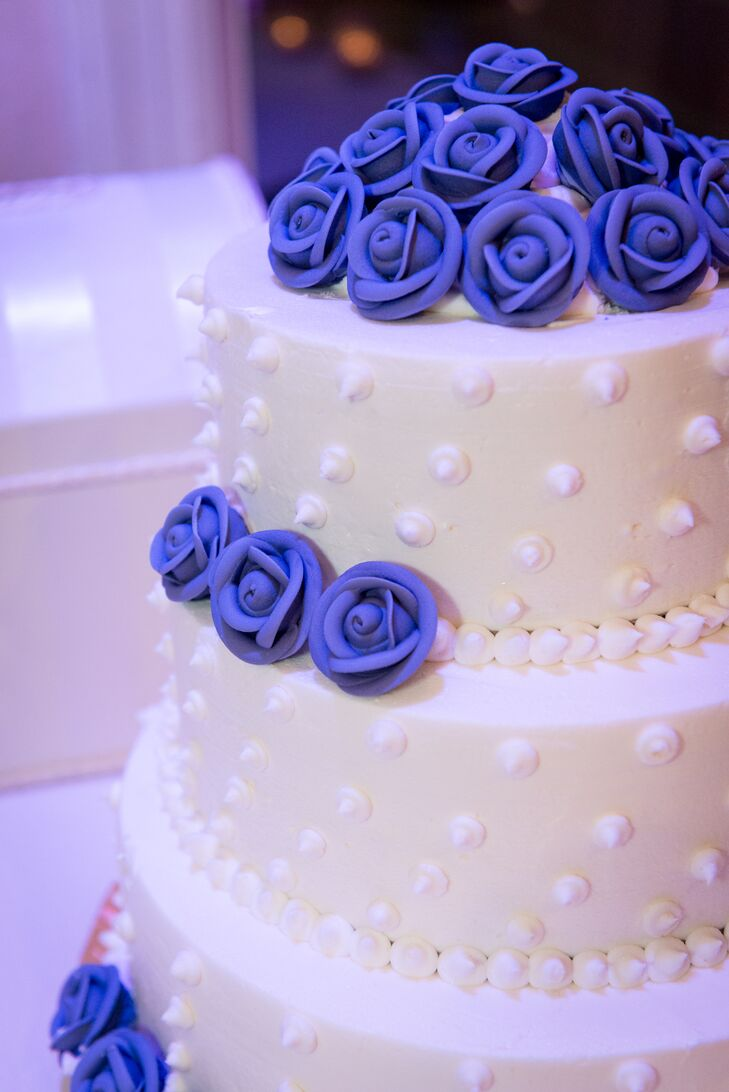 Even the wedding cake had purple details. Purple rosettes circled every layer of the three-tier cake.