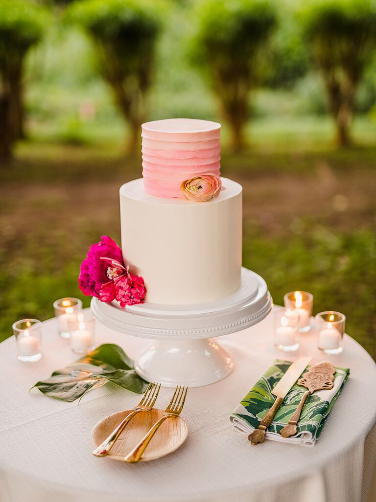Simple wedding cake with pink tier
