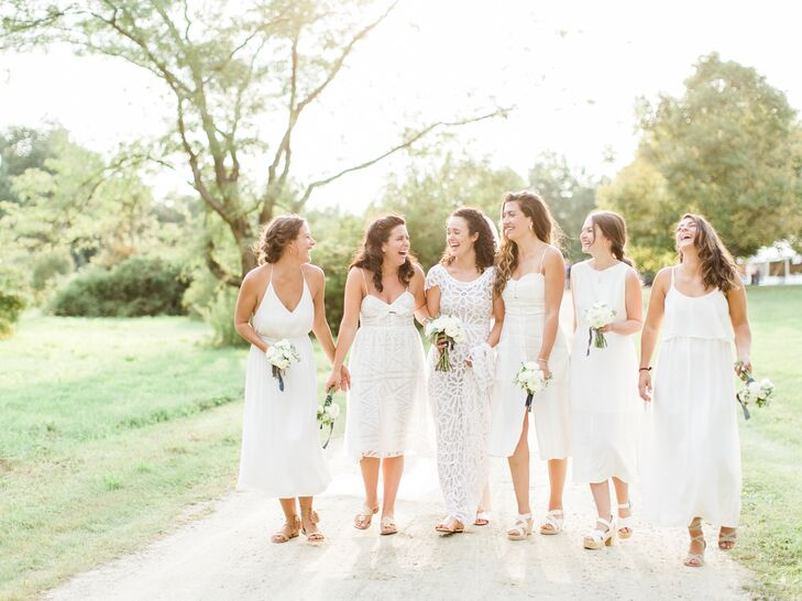 """Christine opted for a casual yet modern look for her bridesmaids, letting them choose their own white dresses. """"Dresses ranges from Rachel Comey to Reformation, and they looked so stunning and ethereal,"""" Christine says. """"I think it was because they were comfortable and felt like themselves."""""""