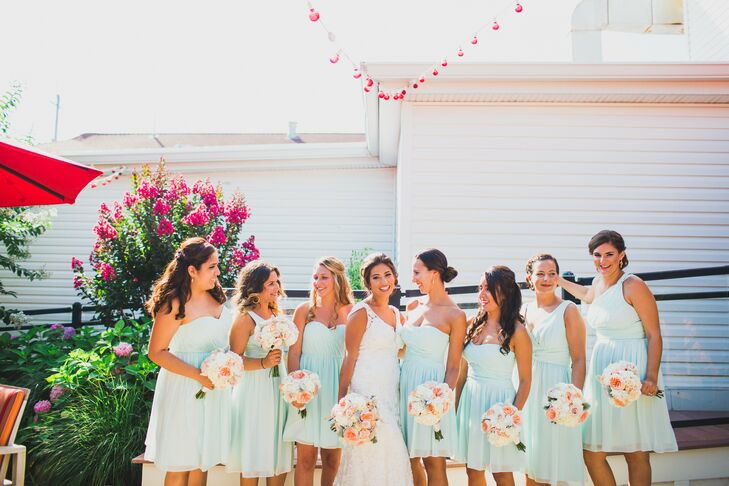 The bridesmaids had a chic take on the blue wedding color, showing off their personalities with short, chiffon Donna Morgan dresses. Each woman got creative and picked out her favorite neckline, as well as her own hairstyle and jewelry. To tie the looks together, they also carried the same hydrangea, garden rose and rose bouquets.