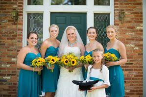 Bridesmaids in Teal, Flower Girl in White with a Blue Sash