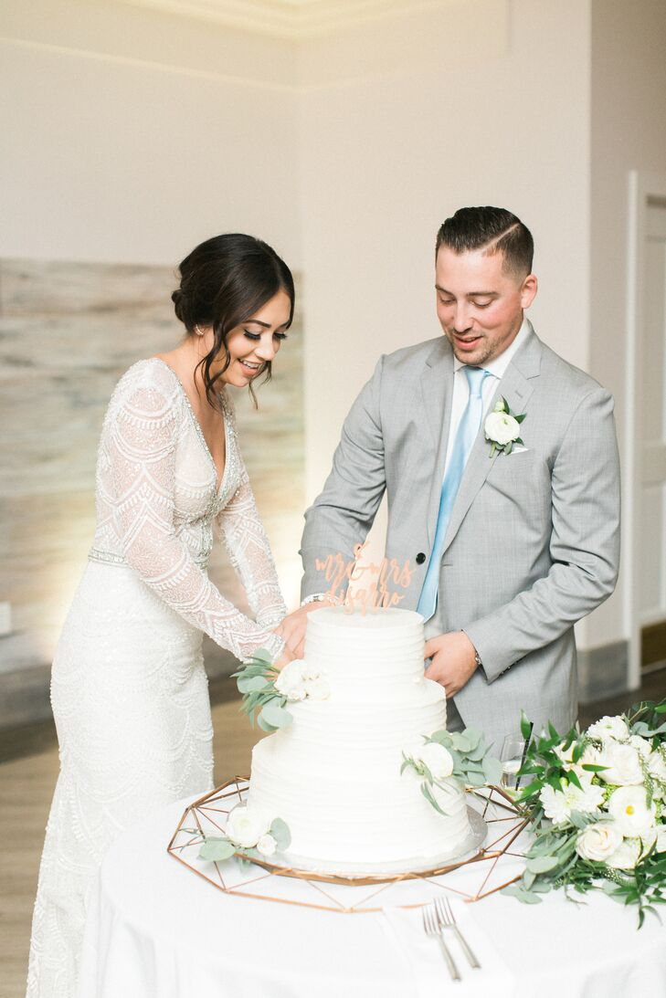 Couple Cutting Cake with Gold Name Topper