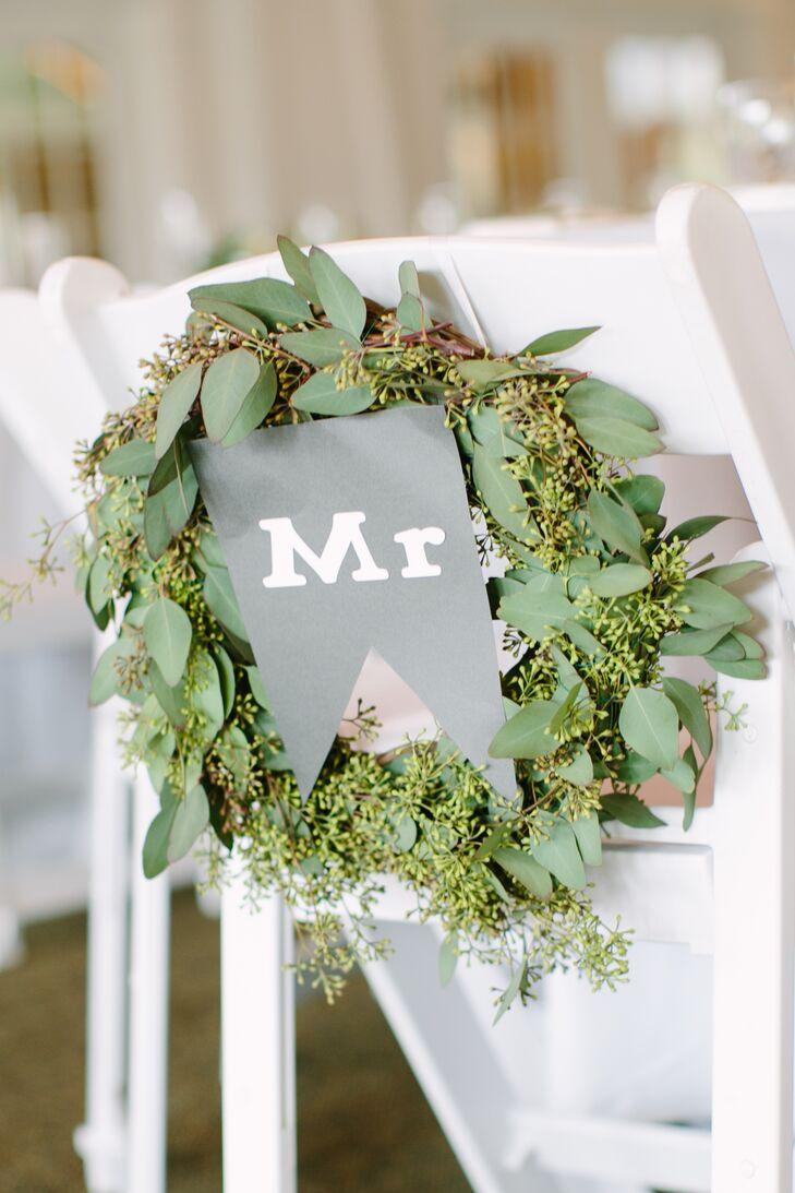 To set their seats apart from the rest, Lynn and Joe decorated their chairs with eucalyptus wreaths, complementing those displayed on the vintage doors during the ceremony, accented with handcrafted Mr. and Mrs. signs.