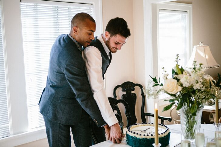 The couple both held onto the cake serving set as they cut through their blue velvet wedding cake, topped with cream cheese frosting and fresh blueberries.