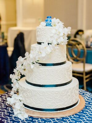 Classic Tiered Cake with Cascading Orchids and Ribbon Detail