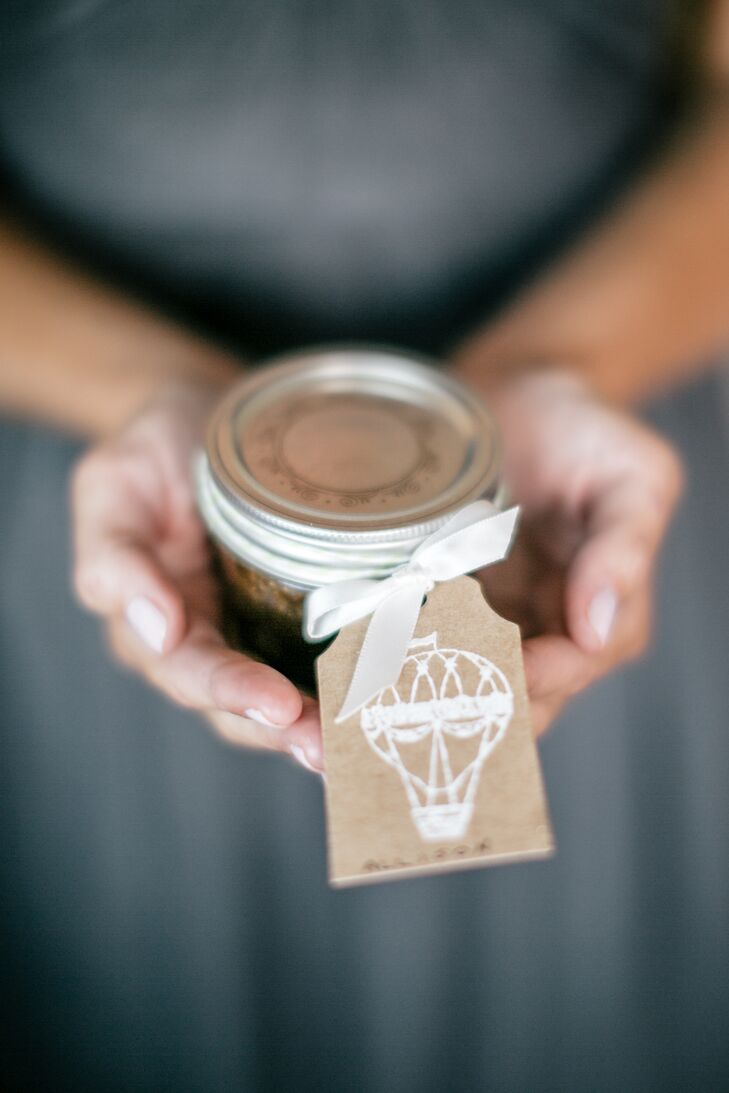 While the decor was largely left up to Amy Young of Leaves of Grass Floral Design, Samantha took on one small DIY project. She made soy candles for all the guests to take home, each decorated with a playful hot air balloon tag displaying the guests' names and seating assignments.