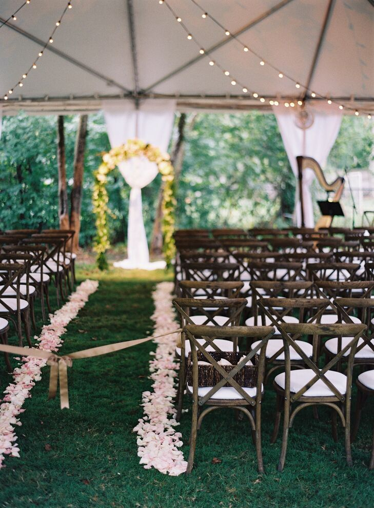 The couple had French country chairs for their ceremony, which added a rustic touch.