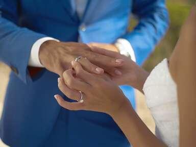 Couple wearing wedding rings