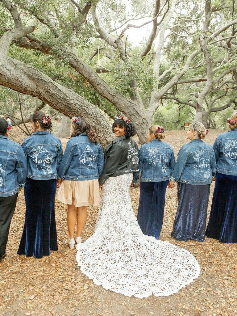 Bridesmaids wearing matching custom wedding denim jackts
