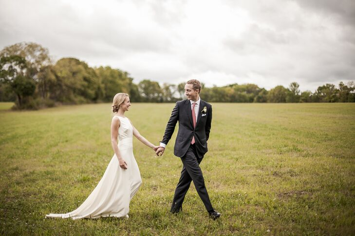 Since her grandparents' farm in Far Hills, New Jersey, has tons of family memories, it was only fitting that Cam and Mike take a stroll around the grounds after their ceremony. He walked in front of her in a custom navy suit tailored by Caruso. He paired it with a poppy Hermes tie to match the bridesmaid dresses. Its horseshoe print, combined with his fox-inspired cuff links, made the look even more personalized.