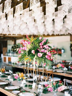 Tall Tropical Centerpieces with Palm Leaves and Pink Flowers