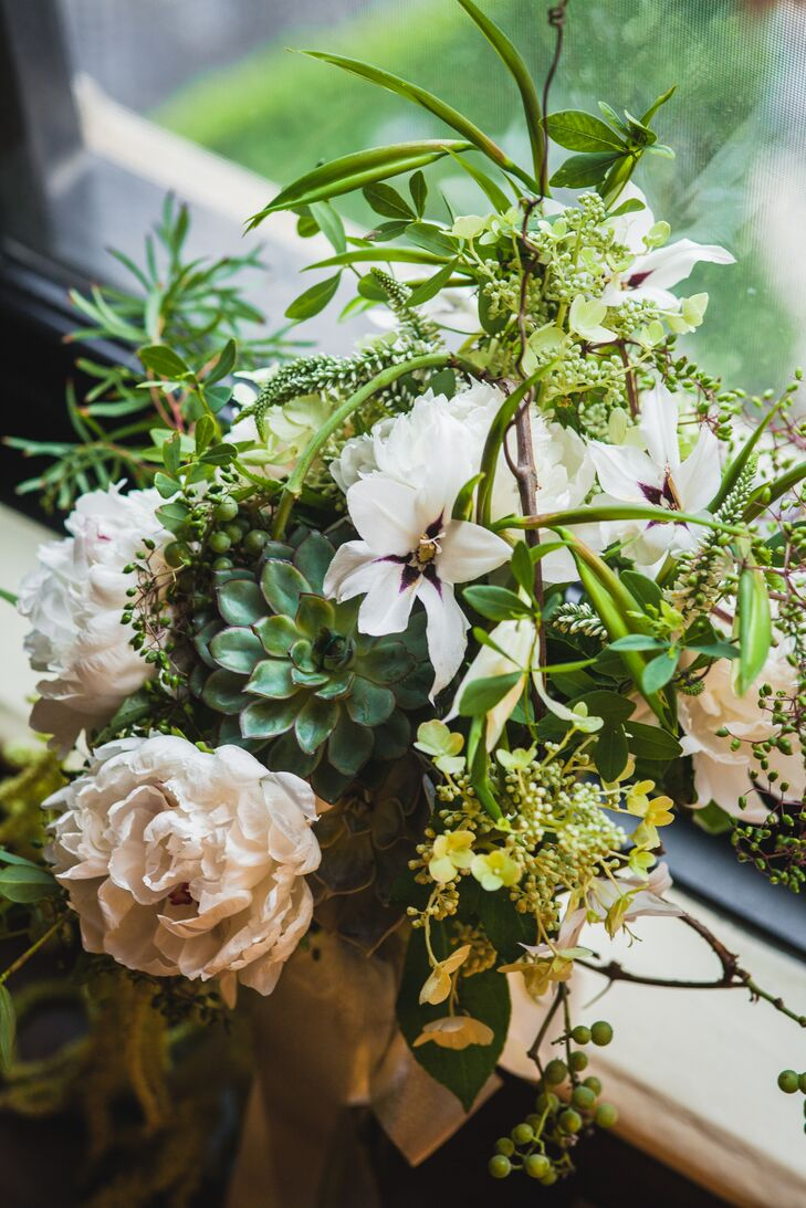 """The staff at A New Leaf was so friendly and literally mastered our arrangements for us,"" the bride says. ""I just loved my bouquet!"""