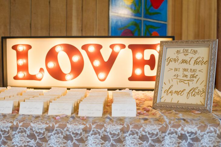 A lighted love sign stood at the table where guests picked up their escort cards.