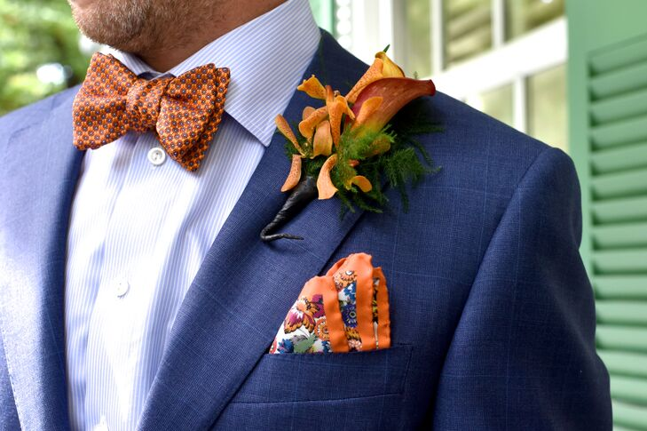 243363fedf00 David stood out in a stunning royal blue suit. His orange pocket square and  boutonniere