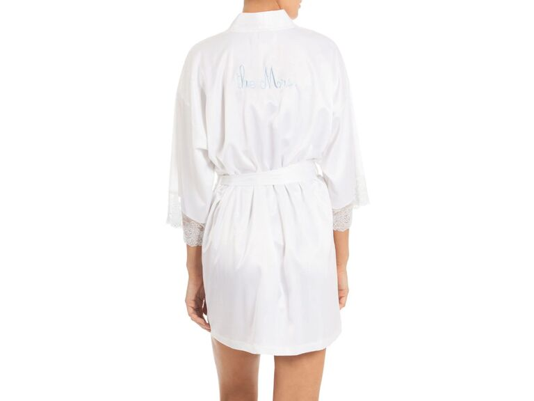Simple white bridal robe with lace sleeves