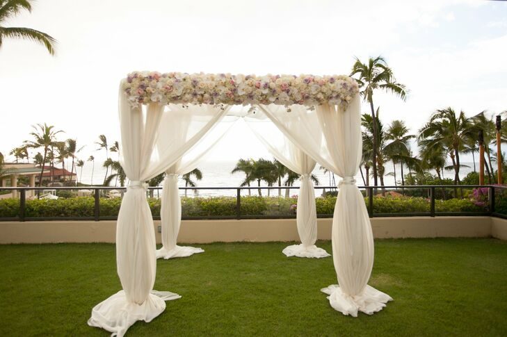 The couple exchanged vows beneath a gauzy, romantic ceremony arch accented with roses and hydrangeas.