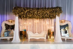 White Sweetheart Chair with Gold-Dipped Leaf Arch and Hanging Chandeliers