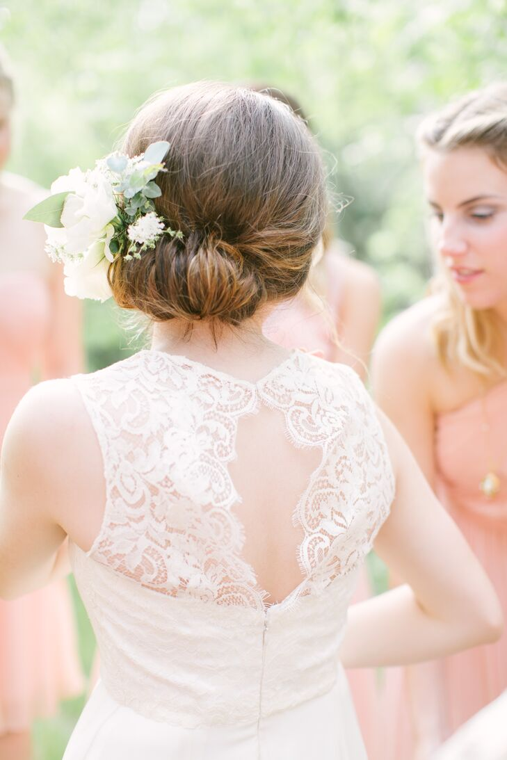Anna wore an ivory Sarah Seven dress on the day of the wedding, which had a lace back that opened up in the middle. She wore her hair styled up on the day of the wedding, accented with ivory blooms.