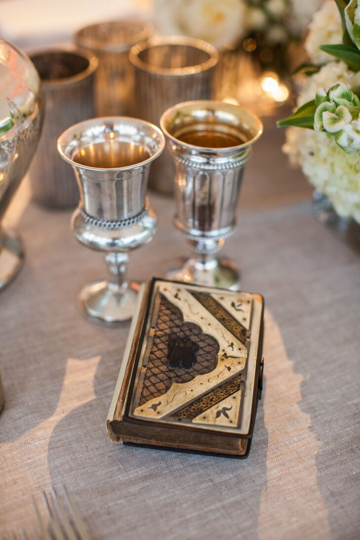 Nora incorporated her ancestors into her ceremony. Not only was she married in her great grandmother's gold wedding band, but she walked down the aisle holding her paternal great grandfather's prayer book.