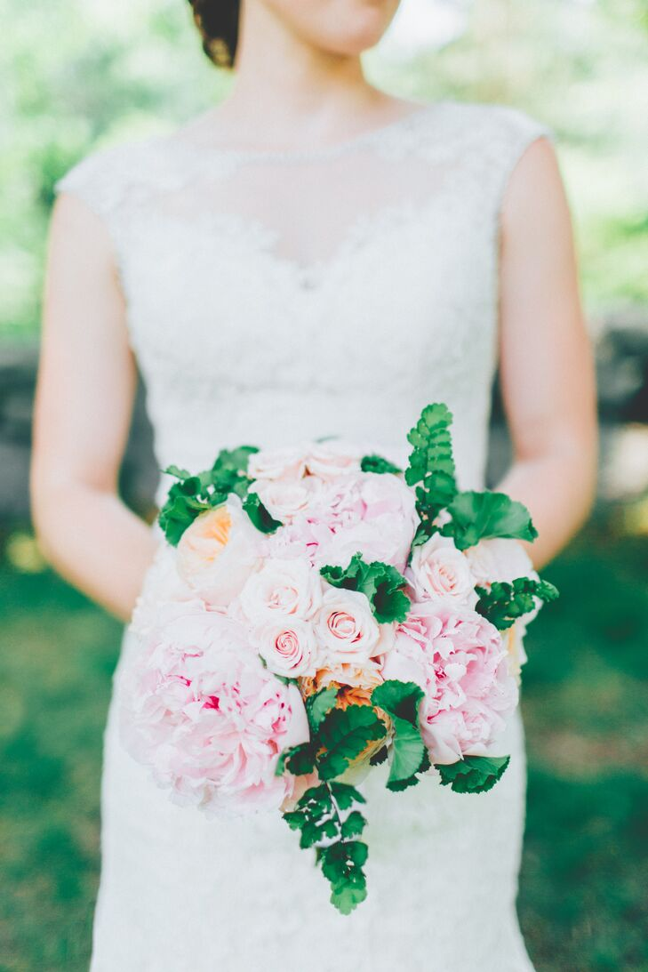Shaylyn worked with York Flower Shop to create a romantic, spring-inspired bouquet that matched the tone of the elegant spring affair. Cabbage roses, Shaylyn's favorite, in a soft shade of coral, pink roses, peonies and bright green ferns filled her bouquet and added a fresh pop of color to her ladylike lace gown.