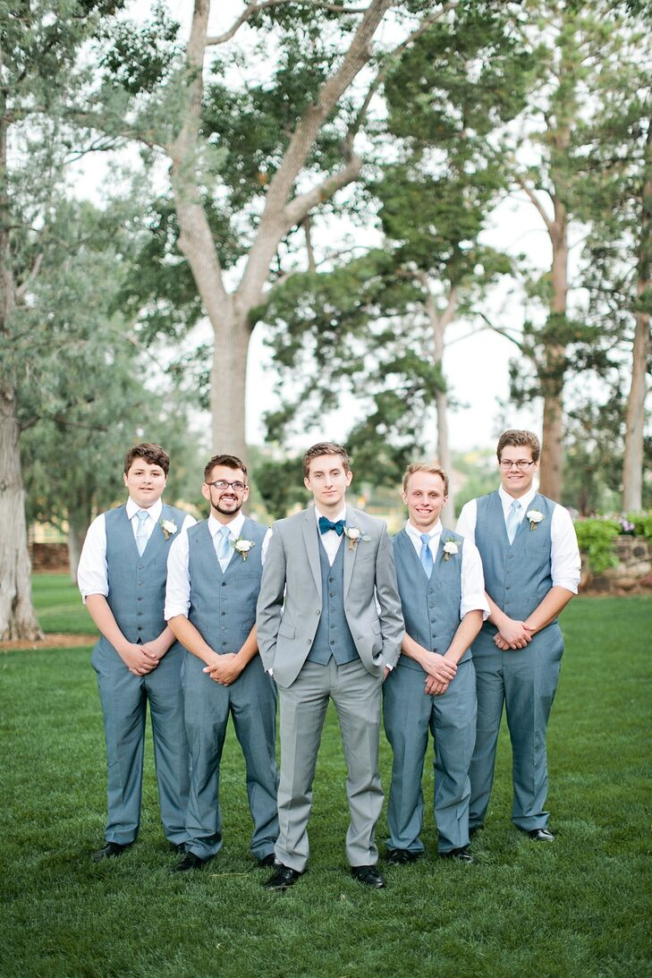 Nick wore a light gray suit with a blue bow tie, a crisp white shirt and a gray vest. The groomsmen followed a similar style, only without the jackets.