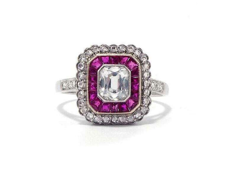 Art deco diamond engagement ring with ruby halo