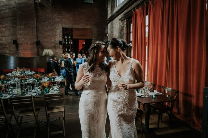 Same-Sex Brides with Lace Wedding Dresses