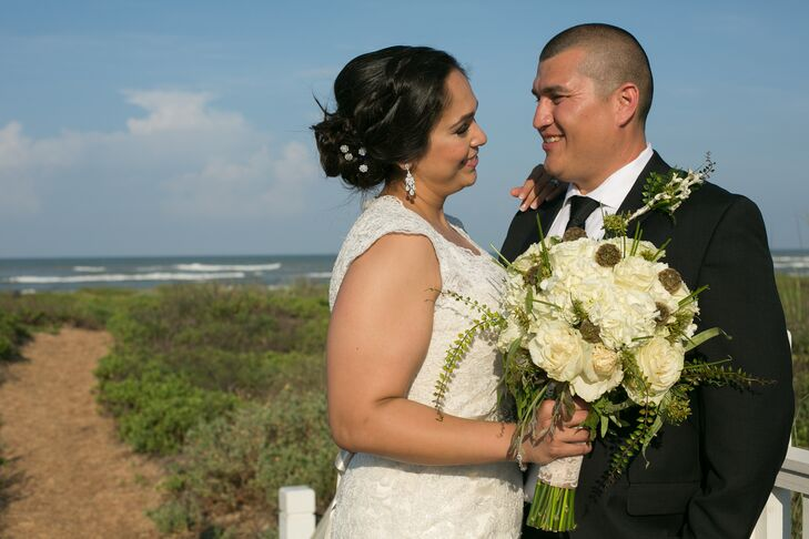 Natalie's bouquet had ivory roses and hydrangeas with scabiosa pods and whimsical, wild greens that evoked the beachy atmosphere of her wedding reception at Namar Event Center in South Padre Island, Texas.