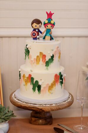 Rainbow-Colored Two-Tier Wedding Cake With Avengers Action Figure Cake Toppers