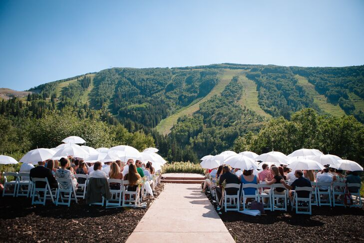 Jen and Chris exchanged vows against a stunning mountainous backdrop. Guests were given parasols to ward off any excessive brightness.