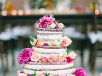 Three-tier naked cake with garden roses and ranunculus