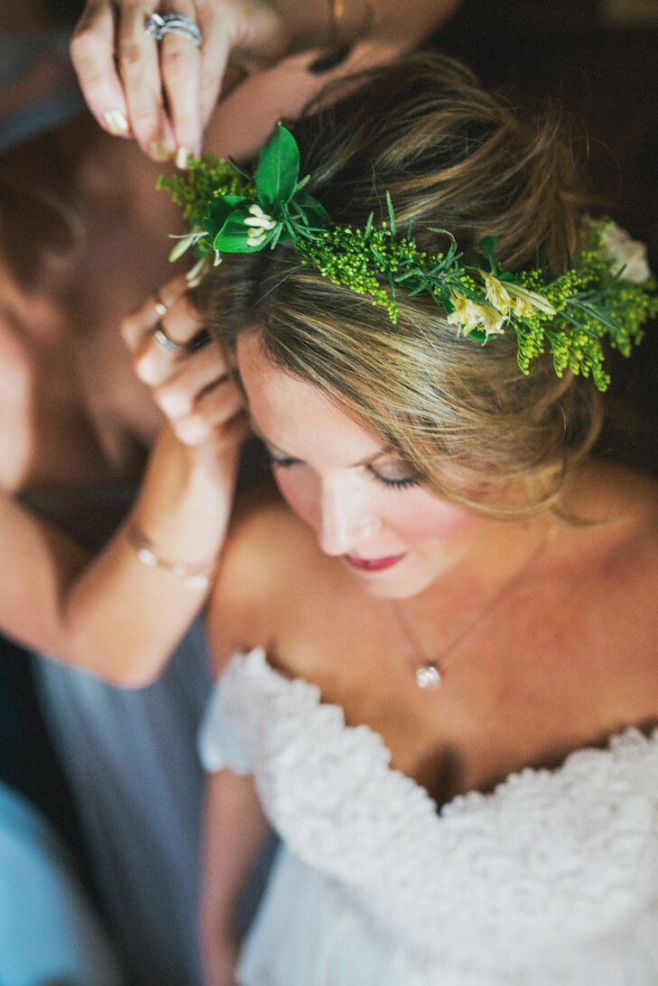 The crown, made of greenery, was also made by Amanda Jewel Floral + Design. Kelley wanted a more bohemian, natural look, which is why she opted for the crown over a traditional veil.