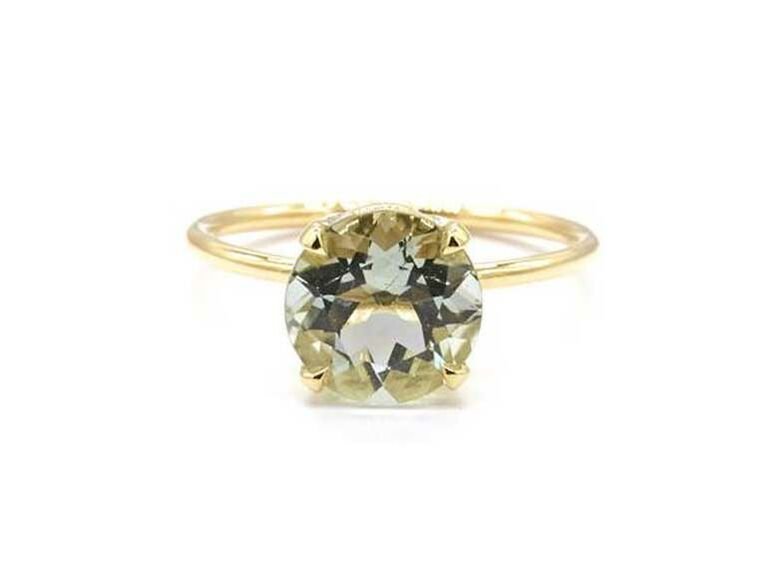Round-cut green amethyst engagement ring with yellow gold band