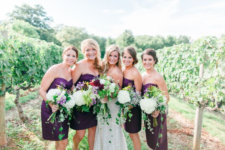 "The bridesmaids wore a short burgundy, strapless J.Crew dress. ""Choosing to have a base color of spiced wine with a hints of gold, burlap and naturalrngreenery was one of the best decisions that I made,"" says Cory. ""By not picking two or three traditional theme colors, but instead letting the vineyard tell that story, it created a very whimsical effect for the day!"""