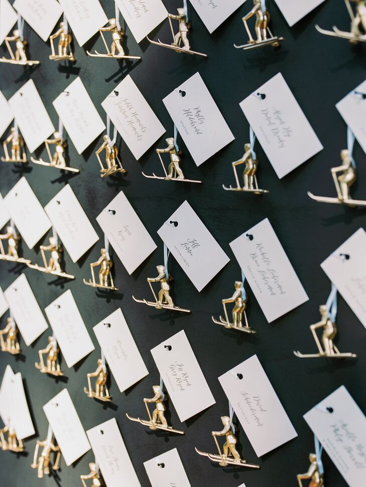 Paper Escort Cars with Gold Skiing Figurines